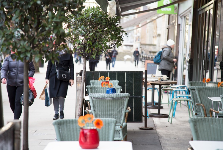 Outside table and chairs with greenery in Ealing street