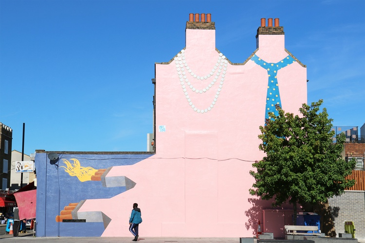 Side-art on house of  chimneys wearing a pearl necklace and tie around their necks in Deptford