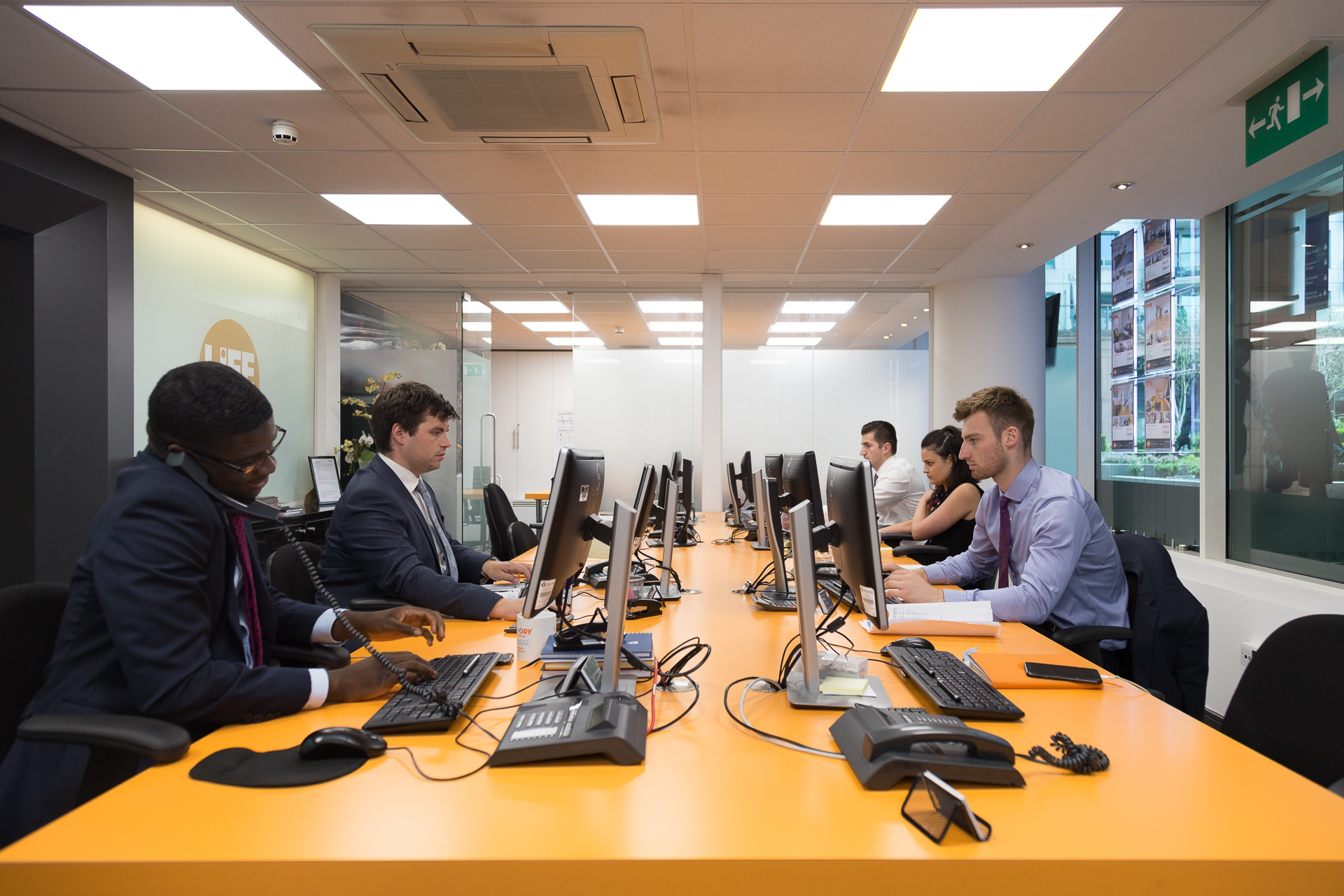 Estate agents making calls in our Nine Elms office