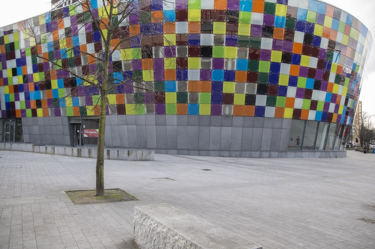 Outside of the Mill in Lewisham, decorated with coloured block squares and a grey rim