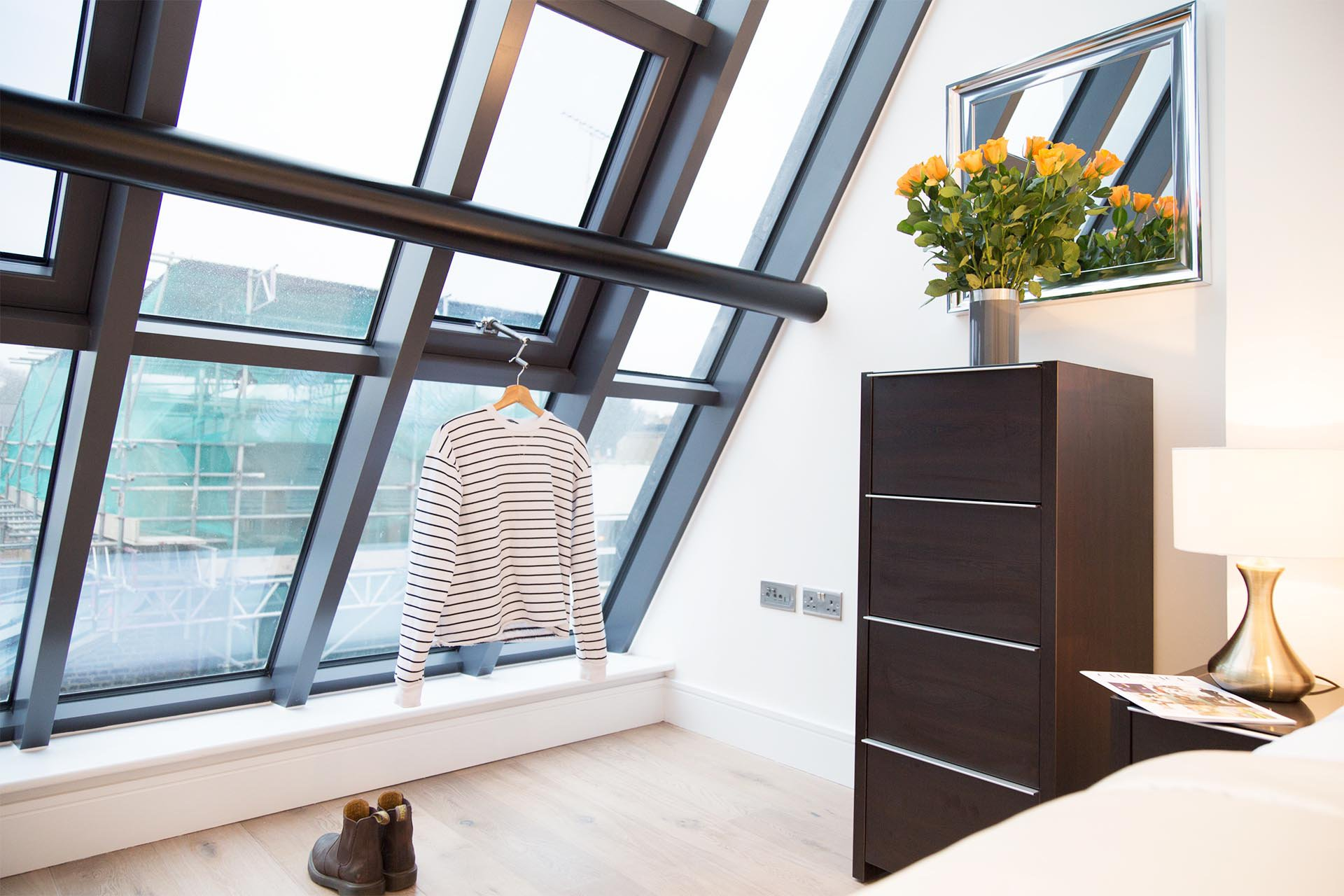 Bedroom interiors image with natural lighting from large window