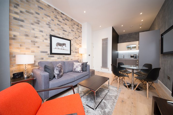 Living room with exposed brickwork wall and zebra artwork