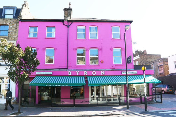 Bright magenta pink Byron Burger building in Clapham