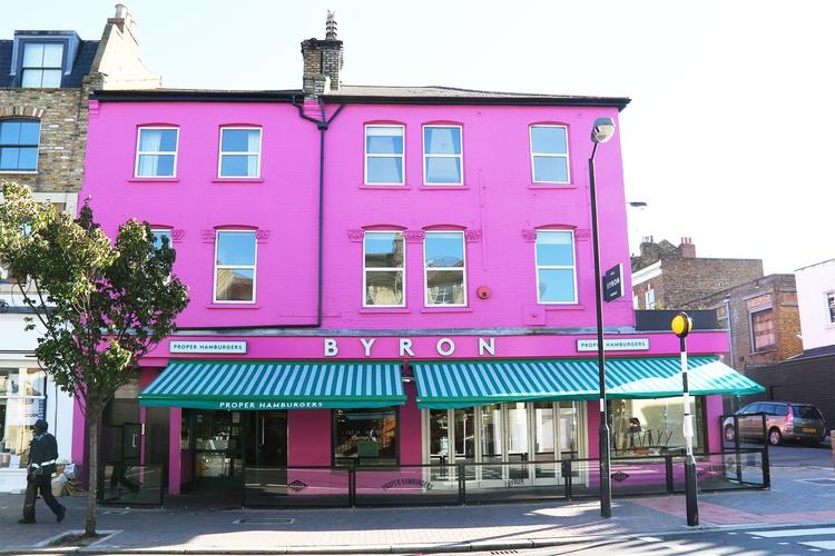 Bright magenta pink Byron Burger building in Clapham