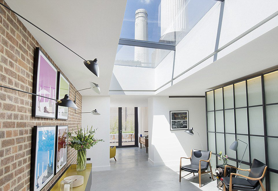 CGI of new home to be built in Battersea Power Station, where the towers can be seen through a ceiling skylight window
